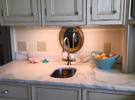 After the KonMari Method, my kitchen counter is clutter-free, with 3 decorative accents placed on the counter for mood. You can spread out your hands and feel the clean marble counter space!